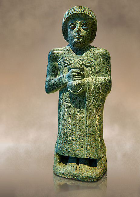 """Diorite statue of Guidea who ruled Lagash from around 2150 BC. The statue called the """"gushing vase"""" dedicated to the goddess Geshtinanna. From the ancient Sumarian city of Lagash."""