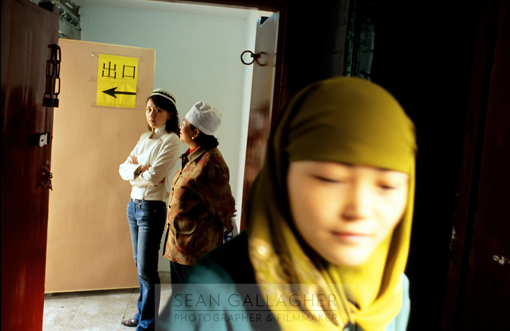 CHINA. Beijing. Women at the Niu Jie Mosque during the festival of Eid-al-Fitr, marking the end of Ramadan. 2005