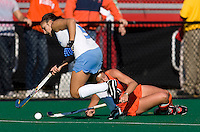Taryn Gjurich (5) of UNC sprints past Carissa Vittese (8) of Virginia during the NCAA Field Hockey Championship semfinals in College Park, MD.  North Carolina defeated Virginia, 4-3, in overtime.