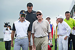Tenniel Chu comes to congratulate Yao Ming, Michael Douglas, and Gary Player at the end of their game during the World Celebrity Pro-Am 2016 Mission Hills China Golf Tournament on 23 October 2016, in Haikou, Hainan province, China. Photo by Marcio Machado / Power Sport Images