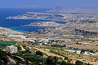 Ghajn Tufieha Bay and Golden Sands Bay, northwest Malta.  Farmland.  Plastic-covered tubes improve growing conditions for vegetables by raising soil and air temperatures and shielding the plants from the wind.