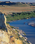 Theodore Roosevelt National Park, ND:  Evening light on badland hills and bend in the Little Missouri River from Wind Canyon Overlook