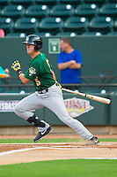 Levi Hyams (5) of the Lynchburg Hillcats follows through on his swing against the Winston-Salem Dash at BB&T Ballpark on August 5, 2013 in Winston-Salem, North Carolina.  The Dash defeated the Hillcats 5-0.  (Brian Westerholt/Four Seam Images)