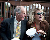 Bruce Miller and Maggie Magnier laugh it up in the winner's circle after Pierrot Lunaire's dramatic win in the Grand National.