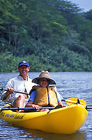 Father and daughters kayaking on the Kalihiwai River, North Shore of Kauai