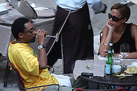 SPIKE LEE & TONYA LEWIS LEE.The Film Award Sesterzio Silver 2008 held at the Jardin de Russie,.Rome 24th June 2008..half length wife married husband wife yellow t-shirt table sitting food drink wine sunglasses drinking.CAP/CAV.©Luca Cavallari/Capital Pictures