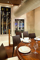 wooden round dining table Milos Restaurant New York City