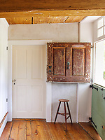 A distressed wooden stable door opens into the kitchen