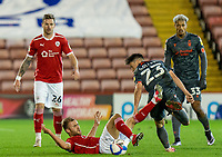 21st November 2020, Oakwell Stadium, Barnsley, Yorkshire, England; English Football League Championship Football, Barnsley FC versus Nottingham Forest; Cauley Woodrow of Barnsley on the floor after a challenge with Joe Lolley of Nottingham Forrest