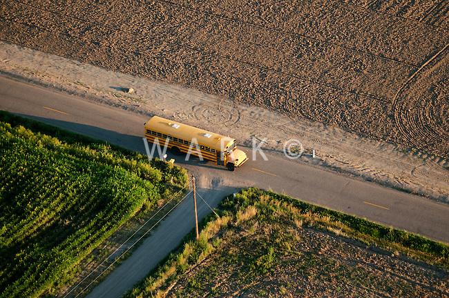 School bus on rural route. Pueblo County, Colorado. August 2011