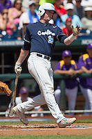North Carolina third baseman Colin Moran (18) follows through on his swing against the Louisiana State Tigers during Game 7 of the 2013 Men's College World Series on June 18, 2013 at TD Ameritrade Park in Omaha, Nebraska. The Tar Heels defeated the Tigers 4-2, eliminating LSU from the tournament. (Andrew Woolley/Four Seam Images)