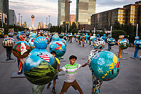 A boy plays among colourful moulded figures representing all the nations taking part in the Astana World Expo from June to September 2017.