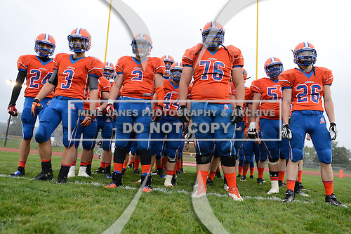 Attica Blue Devils players Zach Kozma (24), Evan Krawczyk (3), Matt Perry (2), Nick James (76), Ryan Perl (51) and Jake Czechowicz (26) line up before introductions before a game against the Holley Hawks at Attica High School on Friday September 13, 2013 in Attica, New York.  Attica defeated Holley 39-0 as the game was stopped at halftime for safety reasons.  (Mike Janes Photography)