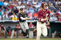 Texas Tech Red Raiders third baseman Easton Murrell (19) makes a throw to first base during Game 9 of the NCAA College World Series against the Florida State Seminoles on June 19, 2019 at TD Ameritrade Park in Omaha, Nebraska. Texas Tech defeated Florida State State 4-1. (Andrew Woolley/Four Seam Images)