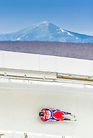 5 December 2014: Adam Rosen, sliding for Great Britain, slides through Curve Number 14 on his first run, ending the day with a 24th place finish and a combined 2-run time of 1:45.025 in the Men's Competition at the Viessmann Luge World Cup, at the Olympic Sports Track in Lake Placid, New York, USA. Mandatory Credit: Ed Wolfstein Photo *** RAW (NEF) Image File Available ***