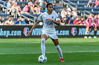 BRIDGEVIEW, IL - JULY 18: Alana Cook #4 of the OL Reign dribbles the ball during a game between OL Reign and Chicago Red Stars at SeatGeek Stadium on July 18, 2021 in Bridgeview, Illinois.