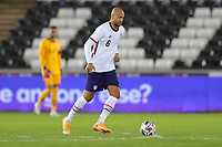 SWANSEA, WALES - NOVEMBER 12: John Brooks #6 of the United States moves with the ball during a game between Wales and USMNT at Liberty Stadium on November 12, 2020 in Swansea, Wales.