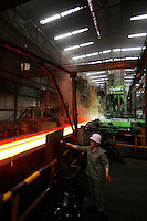 A worker uses a sink next to a production line for H-beams at Ma Steel (Maanshan Iron & Steel Co.) in Maanshan, Anhui Province, China..