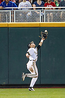 Vanderbilt Commodores outfielder Jeren Kendall (3) makes a running catch against the TCU Horned Frogs in Game 12 of the NCAA College World Series on June 19, 2015 at TD Ameritrade Park in Omaha, Nebraska. The Commodores defeated TCU 7-1. (Andrew Woolley/Four Seam Images)