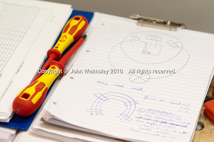 Student electricians' circuit diagrams with two screwdrivers, Able Skills, Dartford, Kent.