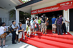 SINGAPORE - MARCH 08:  Visitors enjoy HSBC village during the final round of HSBC Women's Champions at the Tanah Merah Country Club on March 8, 2009 in Singapore. Photo by Victor Fraile / The Power of Sport Images