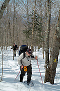 Hikers snowshoeing on  Starr King Trail in the White Mountains, New Hampshire USA