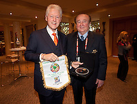 Former United States President Bill Clinton is handed gifts by members of CONMEBOL at the Saxon Hotel in Sandhurst, Johannesburg, South Africa on June 24, 2010.  Clinton is the honorary chairman of the U.S. bid to host the World Cup in either 2018 or 2022.
