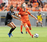 HOUSTON, TX - SEPTEMBER 10: Sophie Schmidt #13 of the Houston Dash clears the ball in front of Katie Johnson #33 of the Chicago Red Stars during a game between Chicago Red Stars and Houston Dash at BBVA Stadium on September 10, 2021 in Houston, Texas.