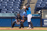 Tampa Tarpons third baseman Andres Chaparro (24) bats during a game against the Lakeland Flying Tigers on July 18, 2021 at George M. Steinbrenner Field in Tampa, Florida.  Also shown, catcher Gresuan Silverio (51) and umpire Michael Corbett.  (Mike Janes/Four Seam Images)