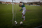 A visiting defender retrieves the ball from the net after the home team scored their third goal at Mount Pleasant as Marske United (in yellow) take on Billingham Synthonia in a Northern League division one fixture. Formed in 1956 in Marske-by-the-Sea, the home club had secured automatic promotion to the Northern Premier League two days before and were in the midst of a run of six home games in 10 days as they attempted to overtake Morpeth Town to win the league. They won this match 6-1 against already relegated Billingham, watched by a crowd of 196.