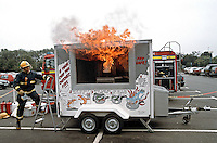 Fire service chip pan fire demonstration trailer unit set up in the car park of a large supermarket. This image may only be used to portray the subject in a positive manner..©shoutpictures.com..john@shoutpictures.com
