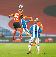 7th November 2020 The John Smiths Stadium, Huddersfield, Yorkshire, England; English Football League Championship Football, Huddersfield Town versus Luton Town;Kiernan Dewsbury-Hall of Luton Town  challenges for a header with Carel Eiting of Huddersfield Town