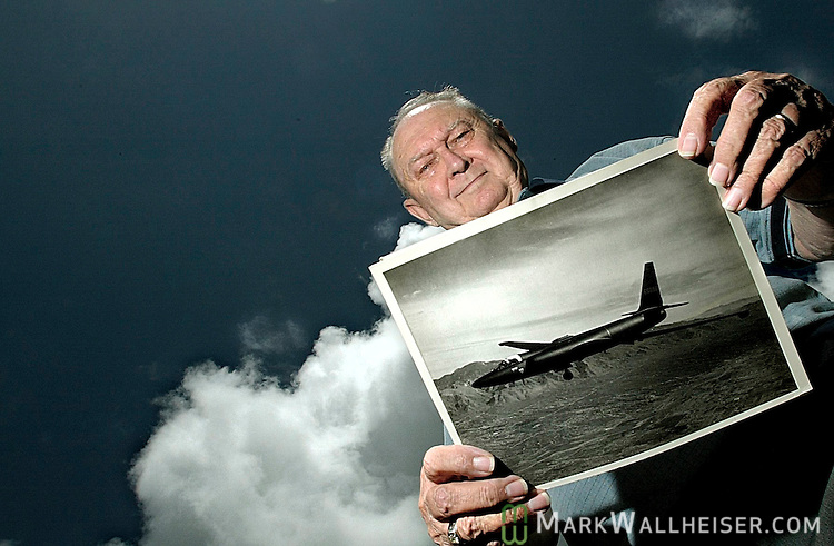 "Former U2 pilot Richard Heyser with a 1960s photo of a CIA ""Blackbird"" U2 spy plane like the one he flew to take photographs of the Cuban missile silos that was the start of the Cuban Missile Crises."