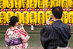 Visitors dressed in traditional Japanese clothing take pictures to the lanterns during the annual ''Mitama Festival'' at Yasukuni Shrine on July, 13, 2015, Tokyo, Japan. Over 30,000 lanterns line the entrance to the shrine to help spirits find their way during the annual celebration for the spirits of ancestors. The festival is held from July 13th to 16th. (Photo by Rodrigo Reyes Marin/AFLO)