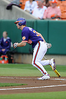 Clemson Tigers catcher Garrett Boulware #30 runs to first during a game against the Florida State Seminoles at Doug Kingsmore Stadium on March 22, 2014 in Clemson, South Carolina. The Seminoles defeated the Tigers 4-3. (Tony Farlow/Four Seam Images)