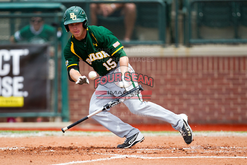 Baylor Bears outfielder Adam Toth #15 heads to first base after laying down a bunt during the NCAA Regional baseball game against Oral Roberts University on June 3, 2012 at Baylor Ball Park in Waco, Texas. Baylor defeated Oral Roberts 5-2. (Andrew Woolley/Four Seam Images)