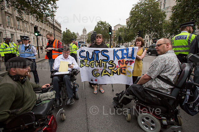 """London, 05/09/2016. Today, to mark the DPAC Week of Action #RightsNotGames, Disabled People Against Cuts (DPAC) held a peaceful demonstration outside the gates of 10 Downing Street. From the organisers press release: <<Join the DPAC crew for a unique show paying homage to Independent Living with poetry, spoken word & performance art plus Masterclasses by the artists at one of the worlds most iconic venues>>. Previously, a group of """"Independent Living"""" campaigners met inside the Houses of Parliament for the launch of 'One Year On: a report into the impact of the closure of the Independent Living Fund' made by Inclusion London (For more information please click here: http://bit.ly/2bS4g1F).<br /> <br /> From the Department for Work and Pension (DWP) website in 2015 when the ILF was still working: <<The Independent Living Fund (ILF) delivers financial support to disabled people so they can choose to live in their communities rather than in residential care. ILF is an executive non-departmental public body of the Department for Work and Pensions>>.<br /> <br /> For more information please click here: http://dpac.uk.net/2016/08/september-2016-week-of-action-september-4th-10th-rights-not-games/ & https://www.facebook.com/disabledpeopleagainstcuts/"""