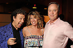 """From left: Little Jewford with Amy and John McCall at a reception held after a reading of """"Becoming Kinky: The World According to Kinky Friedman"""" at the Stages Repertory Theater Friday Aug. 13,2010.(Dave Rossman/For the Chronicle)"""