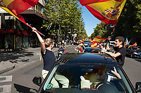 MADRID, SPAIN - OCTOBER 12: Young people wave Spanish flags from a car during a protest against the Government summoned by VOX, Spanish far-right party and third biggest party in the Parliament, on 12 October 2020, in Madrid, Spain. The demonstration coincides with the National Day in Spain after the Government declared state of alarm in the Madrid region on previous Friday to slow down the high Covid-19 cases in some municipalities of this region. (Photo by Sergio Belena/VIEWpress via Getty Images).