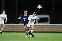 CHAPEL HILL, NC - NOVEMBER 16: Shannon Maitland #10 of Belmont University heads the ball away from Madison Schultz #1 of the University of North Carolina during a game between Belmont and North Carolina at UNC Soccer and Lacrosse Stadium on November 16, 2019 in Chapel Hill, North Carolina.
