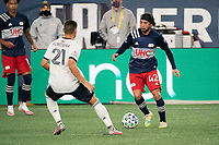 FOXBOROUGH, MA - OCTOBER 19: Lee Nguyen #42 of New England Revolution dribbles as Anthony Fontana #21 of Philadelphia Union comes in to tackle during a game between Philadelphia Union and New England Revolution at Gillette on October 19, 2020 in Foxborough, Massachusetts.