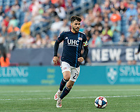 FOXBOROUGH, MA - JUNE 26: Carles Gil #22 dribbles at midfield during a game between Philadelphia Union and New England Revolution at Gillette Stadium on June 26, 2019 in Foxborough, Massachusetts.