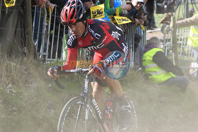 The tail end of the peloton including Manuel Quinziato (ITA) BMC Racing Team climbs Koppenberg during the 96th edition of The Tour of Flanders 2012, running 256.9km from Bruges to Oudenaarde, Belgium. 1st April 2012. <br /> (Photo by Eoin Clarke/NEWSFILE).