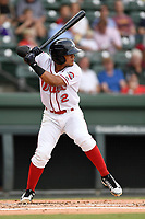 Shortstop Santiago Espinal (2) of the Greenville Drive bats in a game against the Asheville Tourists on Wednesday, August 2, 2017, at Fluor Field at the West End in Greenville, South Carolina. Greenville won, 1-0. (Tom Priddy/Four Seam Images)
