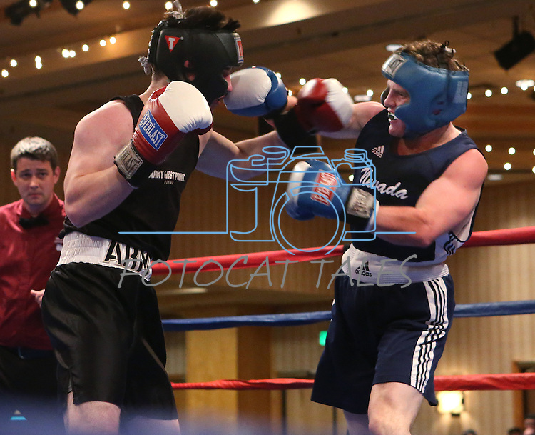 Nevada's Zach Smith defeats Army's Joe Broderick during a National Collegiate Boxing Association bout at the El Dorado Casino in Reno, Nev. on Friday, Feb. 5, 2016. <br /> Photo by Cathleen Allison