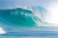 Large empty wave breaking on the north shore of Oahu.