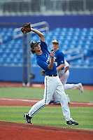 Pitcher Jackson Isaac McPherson (7) of Whiteville High School in Clarendon, NC catches a pop fly during the Atlantic Coast Prospect Showcase hosted by Perfect Game at Truist Point on August 22, 2020 in High Point, NC. (Brian Westerholt/Four Seam Images)