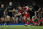 Wales scrum half Rhys Webb bursts through the All Blacks defence to score a try.<br /> Dove men Series 2014<br /> Wales v New Zealand<br /> 22.11.14<br /> ©Steve Pope -SPORTINGWALES