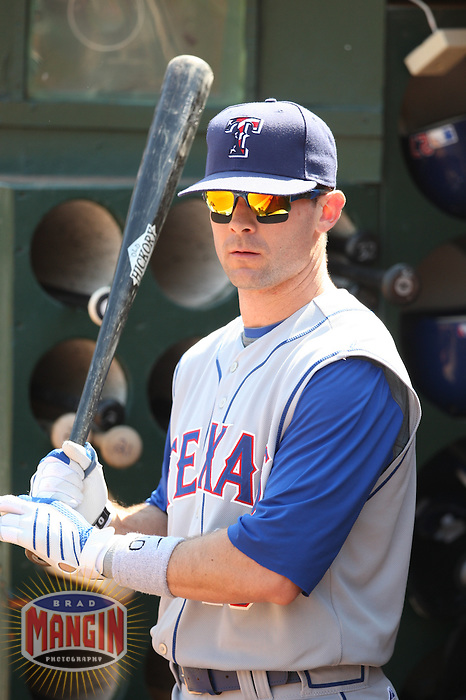 OAKLAND, CA - SEPTEMBER 14:  Michael Young of the Texas Rangers gets ready in the dugout before the game against the Oakland Athletics at the McAfee Coliseum in Oakland, California on September 14, 2008.  The Athletics defeated the Rangers 7-4.  Photo by Brad Mangin