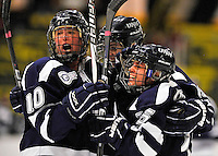 29 January 2012: University of New Hampshire Wildcats celebrate a goal against the University of Vermont Catamounts at Gutterson Fieldhouse in Burlington, Vermont. The Lady Cats edged out the Lady Wildcats 2-1 to split their Hockey East twin-game weekend series. Mandatory Credit: Ed Wolfstein Photo